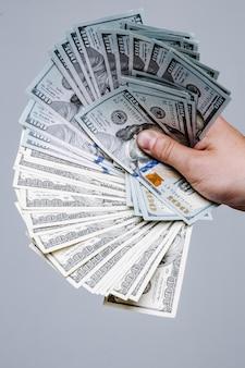 One hundred dollar bills on gray