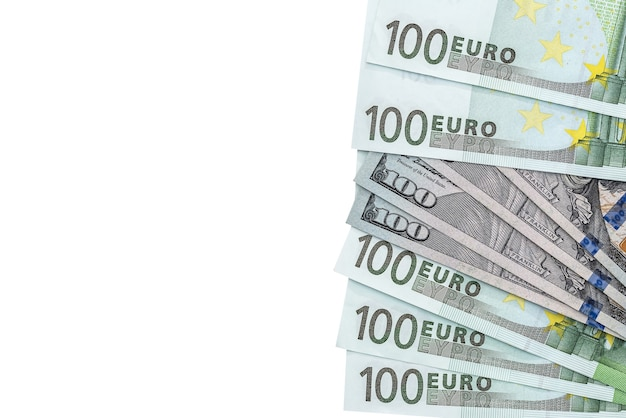 One hundred dollar and euro banknotes isolated on white