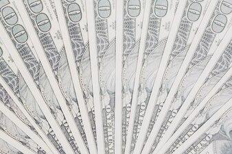One hundred dollars bills spread out in fan shape