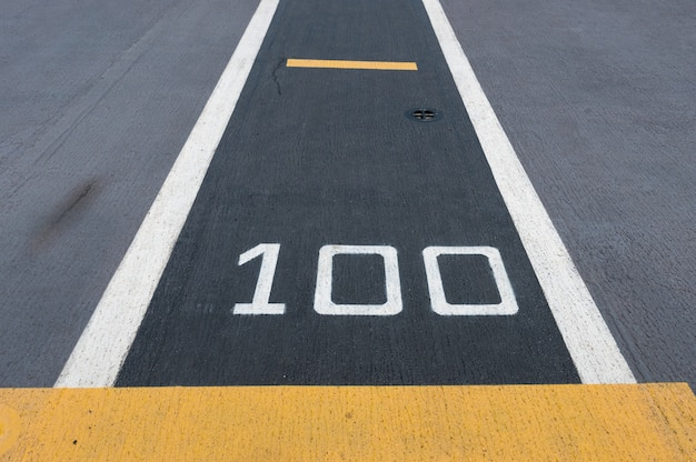 One hundred meters, runway on an aircraft carrier(abstract meaning apply for one hundred).