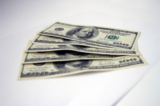 One hundred us dollar bill or banknotes on the white background