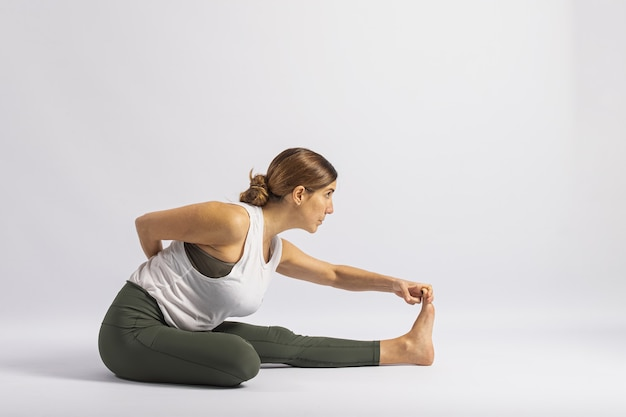 One leg folded forward bend pose. yoga posture (asana)