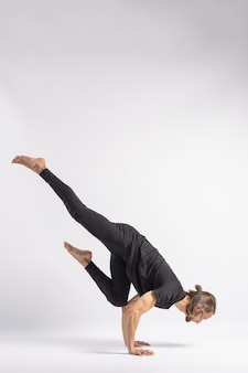 One legged crane pose. yoga posture (asana)