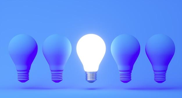 파란색 파스텔 색상 벽 배경에 불이 켜지지 않은 백열 전구로 빛나는 전구