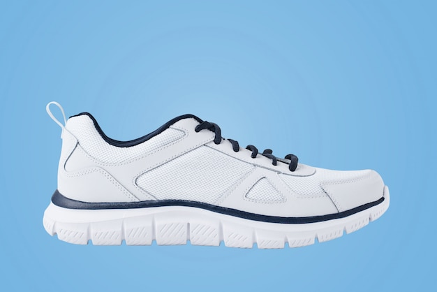 One male white sneakers on a blue . sport shoe close up