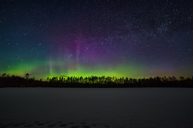 One million stars during the northern lights. sweden. long exposure. milky way