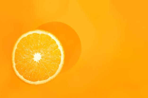 One orange on orange. art food concept
