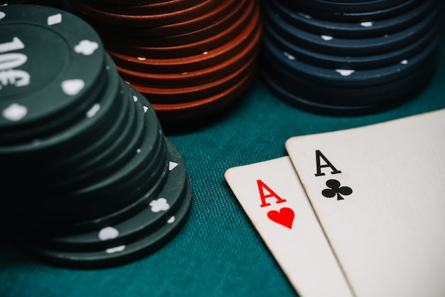 One pair of aces and playing chips in a game of poker