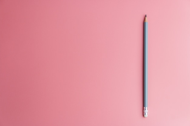 One pencil on a red . minimal workspace for designs