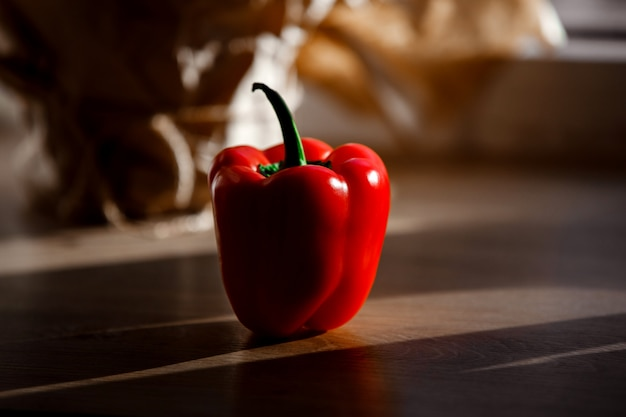 One pepper. natural, organic red pepper on wood