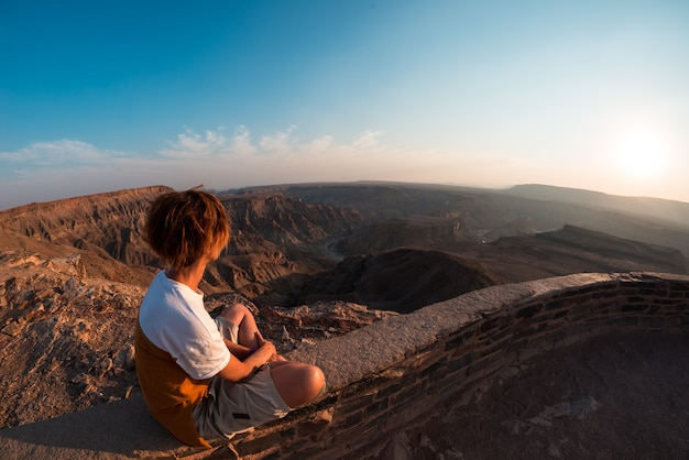 One person looking at the fish river canyon, scenic travel destination in southern namibia