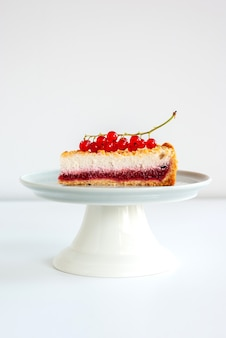 One piece of cottage cheese cake with red currant berries
