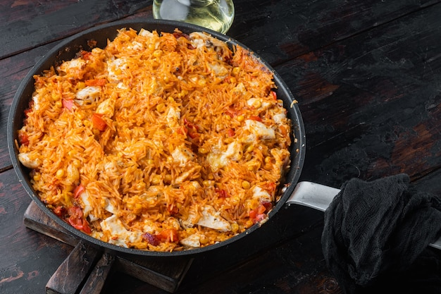 One pot chicken enchilada rice casserole on old dark wooden table