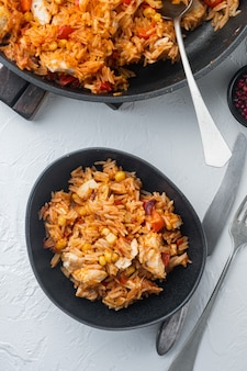 One pot chicken enchilada, rice casserole, on white table, top view flat lay