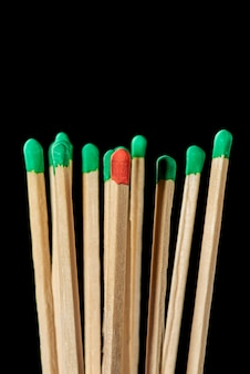 One red match in a group of green matches emotional burnout stress infection of others