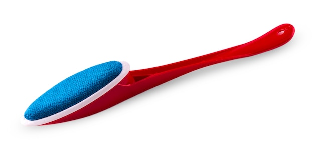 One red plastic brush for cleaning clothes - isolated on white