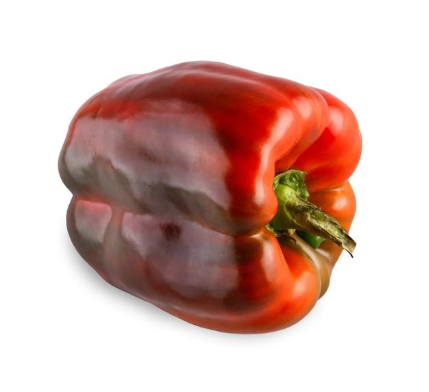 分離された1つの熟した赤ピーマン。緑の新鮮な花柄、健康的な自然有機食品と理想的な唐辛子野菜のクローズアップ画像