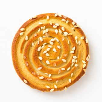 One round cookies with sesame seeds. square. white background