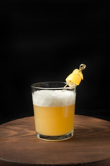 One shot of whiskey sour cocktail - bourbon with lemon juice