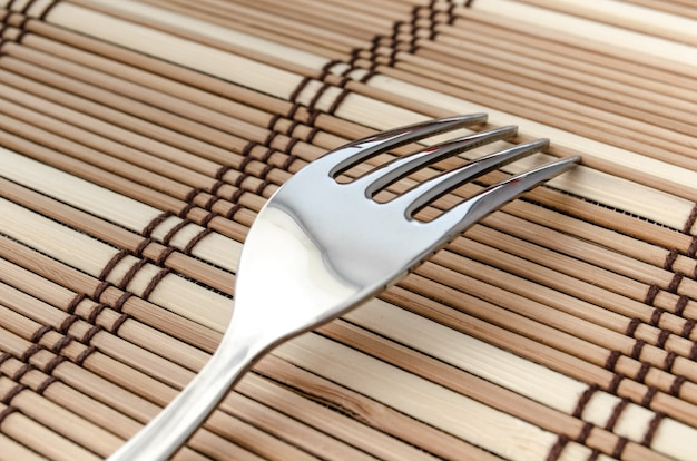 One silver fork on a napkin