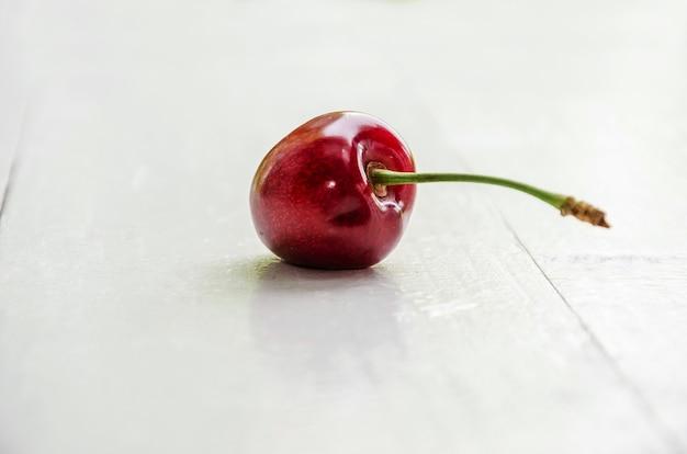 One sweet cherry  on white
