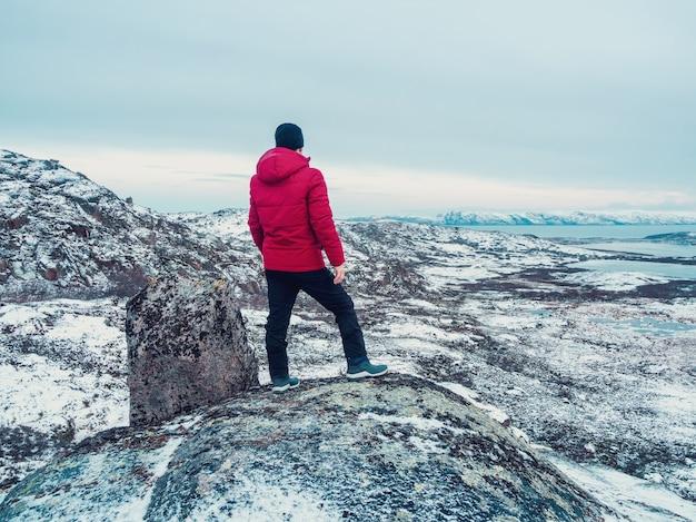 One on top of a mountain. a man on top of a polar hill. wonderful polar landscape. kola peninsula.