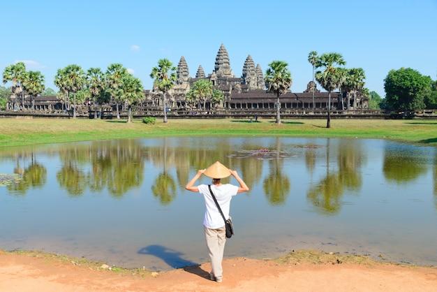 One tourist visiting angkor wat ruins at sunrise