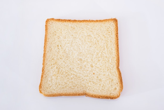 One white slice of bread on a white plate. toast bread.