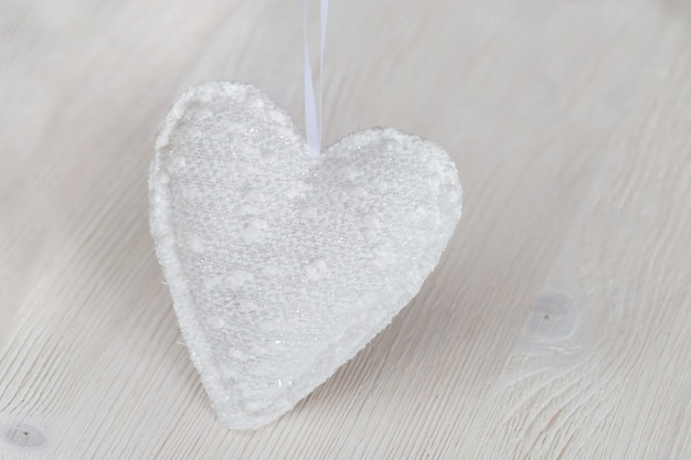One white soft textile heart