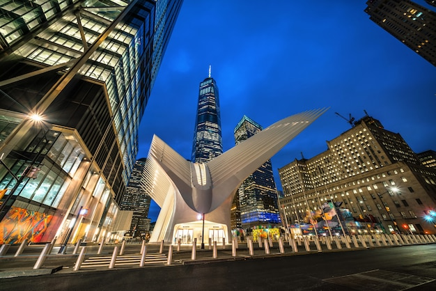 One world trade center and oculus transportation hub entrance at twilight time in lower manhattan