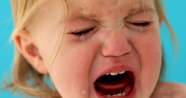 One-year-old baby cries close-up