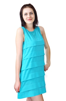 One young woman 18 years old, in light blue, short, summer dress without sleeves, girl standing smiling.