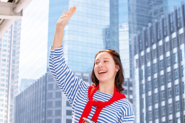One young woman teenager is waving hand greeting