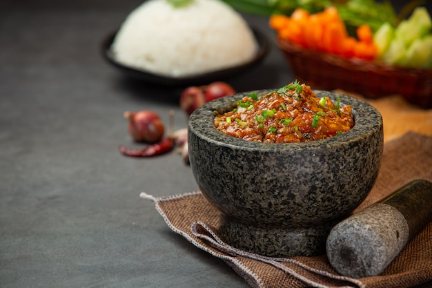 Ong chili paste in a mortar decorated with beautiful side dishes.