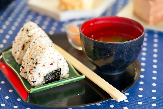 Onigiri rice balls with pickled ginger and miso soup