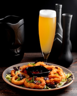 Onion rings served with lettuce sauce and beer