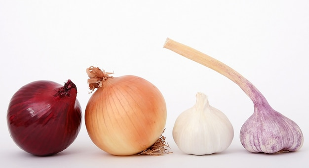 Onions and garlic isolated on white