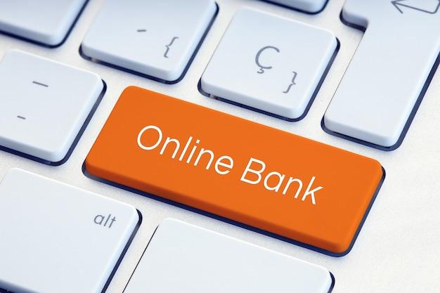 주황색 키보드 키에 온라인 은행 단어