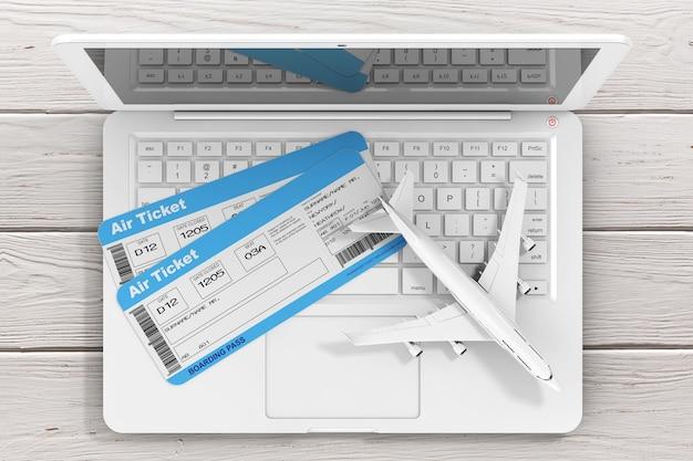 온라인 예약 개념입니다. 나무 테이블 극단적인 근접 촬영에 노트북을 통해 제트 비행기와 항공사 탑승권 티켓. 3d 렌더링
