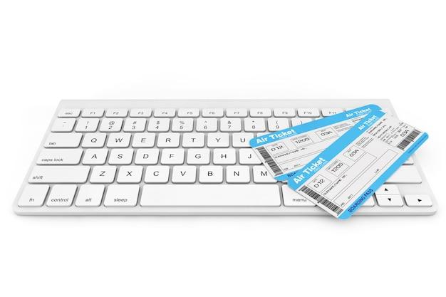 オンライン予約のコンセプト。白い背景の上の航空券とコンピューターのキーボード
