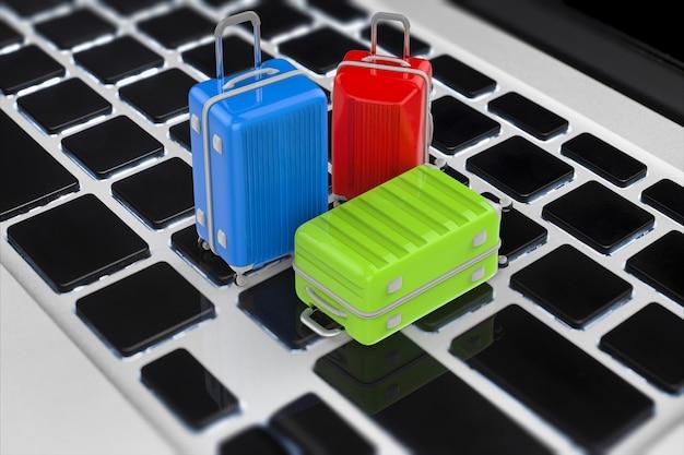 Концепция онлайн-бронирования с 3d-рендерингом дорожного багажа на клавиатуре