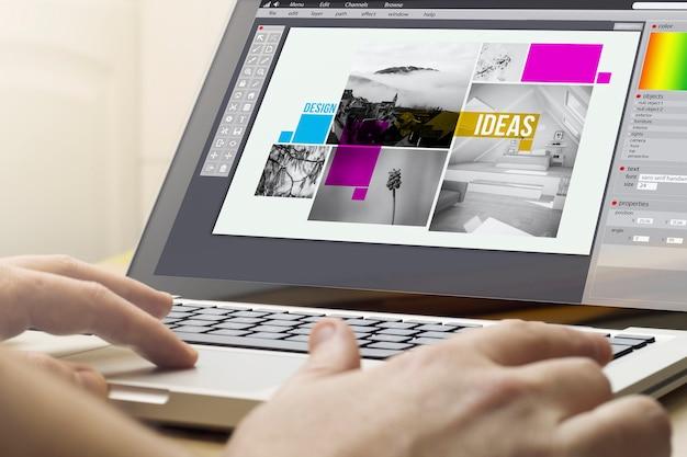 온라인 비즈니스 개념. 화면에 그래픽 디자인 소프트웨어와 함께 노트북을 사용하는 사람.