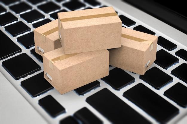 키보드에 3d 렌더링 판지 상자가 있는 온라인 비즈니스 개념 프리미엄 사진