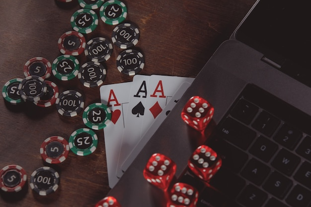 Online casino concept. playing chips, dices and cards on a wooden background.