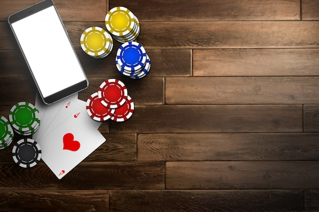 Online casino, mobile casino, top view of a mobile phone, chips cards on wood