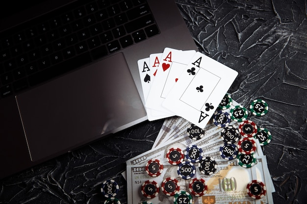 Online casino theme. gambling chips and playing cards on grey background.