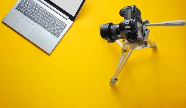 Online concept blogger, reviewer. camera on tripod, laptop. minimalism.