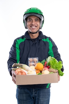 Online driver courier carrying groceries