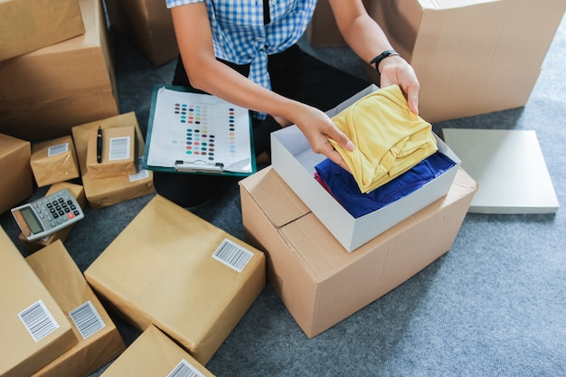 Online fashion seller packing the product