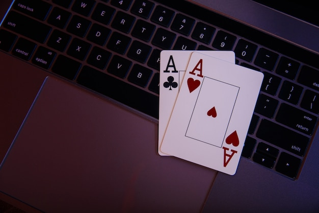 Online gambling theme. aces on a laptop's keyboard. top view.
